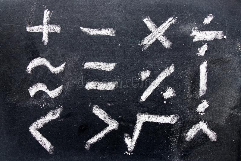 Set of math symbol draw by chalk on black board. Background stock photos