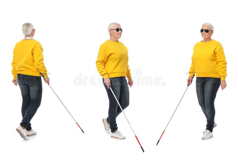 Set of mature blind woman with long cane walking on white royalty free stock image