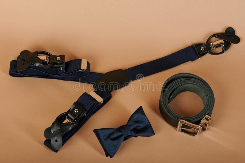 Set of men accessories. Bow tie, suspenders and black belt royalty free stock photography