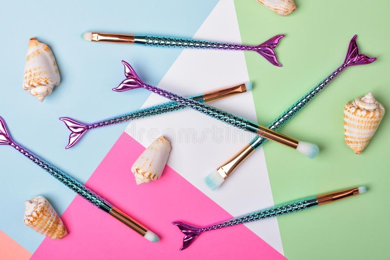 Set of mermaid tail make-up brushes. stock image