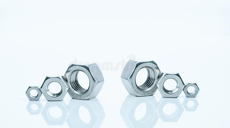 Set of metal hexagon nuts isolated on white background. Small, medium, and big of silver metal hexagon nuts. Hardware tool. Fastener with a threaded hole stock photos