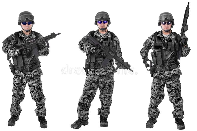 Set of military soldiers in black camouflage, isolated on white stock photo