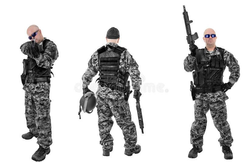 Set of military soldiers in black camouflage, isolated on white backgroud. stock photography