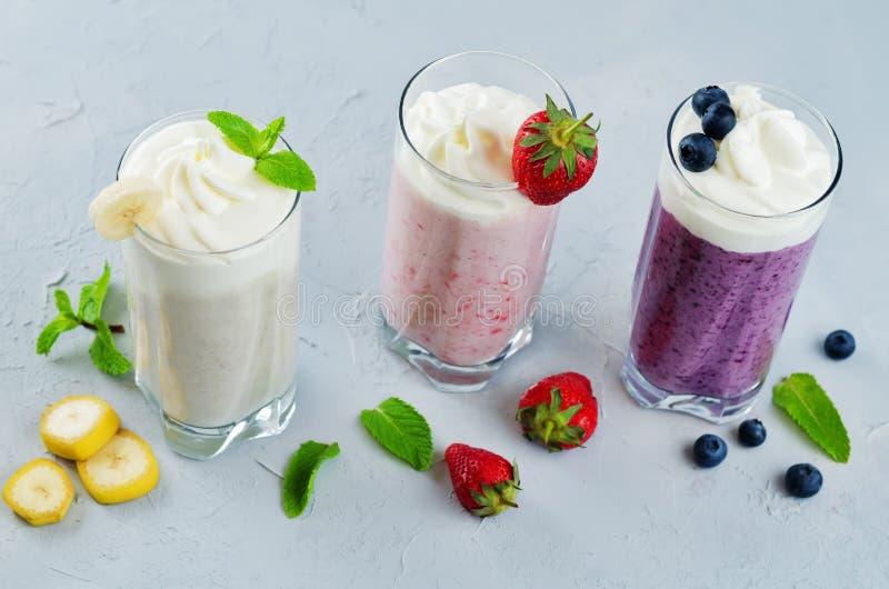 Set of milkshakes: banana, strawberry and blueberry. Toning. selective Focus stock photos
