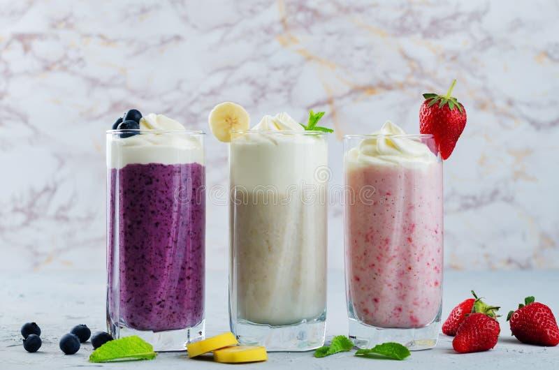 Set of milkshakes: banana, strawberry and blueberry. Toning. selective Focus royalty free stock images