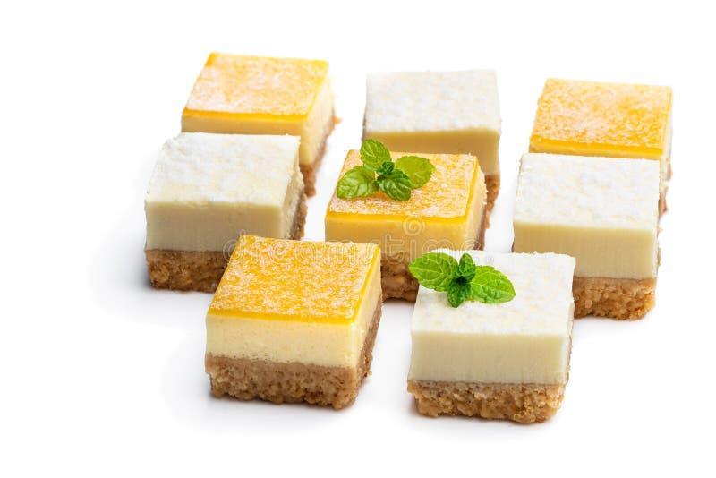 Set of mini lemon and vanilla cheesecake bites isolated on white stock photography