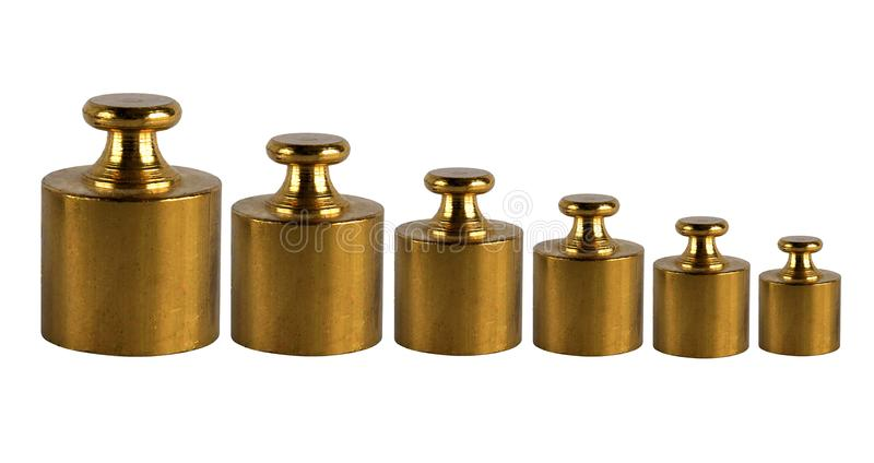 A set of miniature bronze vintage weights royalty free stock images