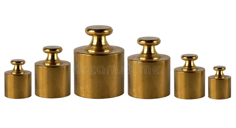 A set of miniature bronze vintage weights royalty free stock photo