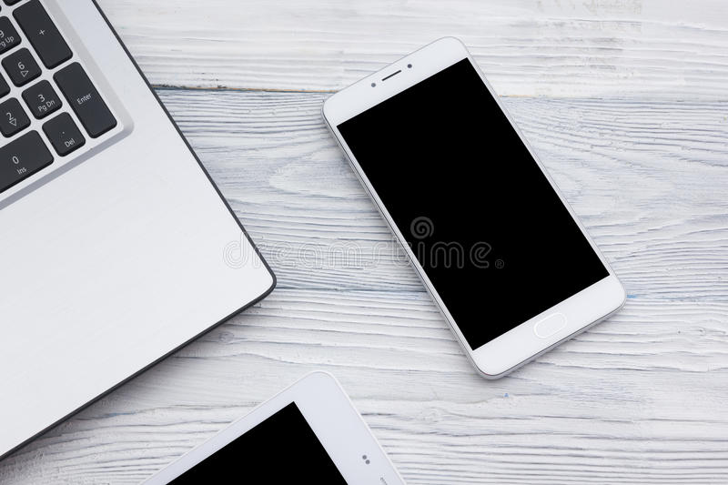 Set of modern computer devices - laptop, tablet and phone close up.  stock photo