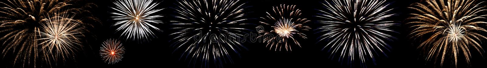 Set of multi-colored fireworks with blue and red sparks on an isolated black background for the design of the holidays; the new ye. Ar; as well as the stock photos