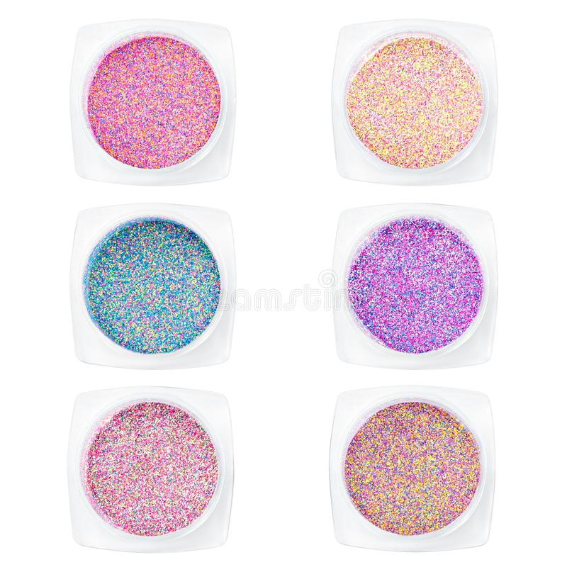 Set multi-colored Sequins for design of nails in box. Glitter in jars. Foil for nail service. Sparkling beauty shimmer, glitter. Set multi-colored Sequins for royalty free stock images