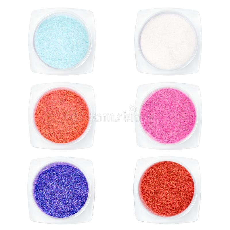 Set multi-colored Sequins for design of nails in box. Glitter in jars. Foil for nail service. Sparkling beauty shimmer, glitter. Set multi-colored Sequins for stock images