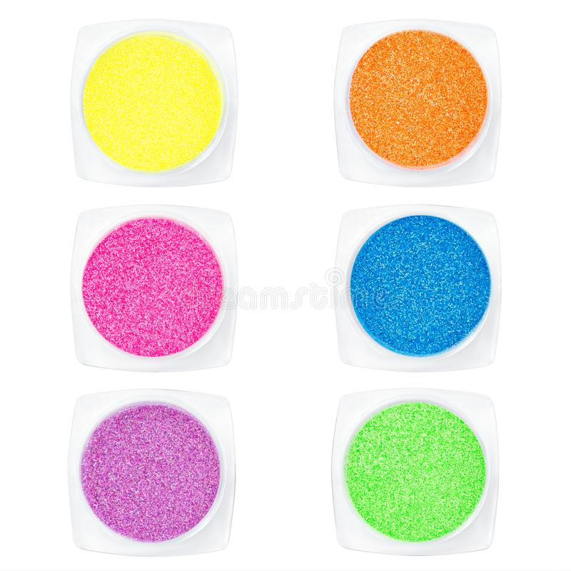 Set multi-colored Sequins for design of nails in box. Glitter in jars. Foil for nail service. Sparkling beauty shimmer, glitter. Set multi-colored Sequins for stock photography