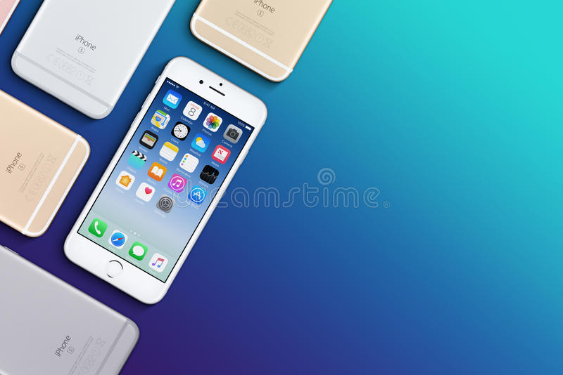 Set of multicolored Apple iPhones 6s flat lay top view lies on surface with copy space stock images