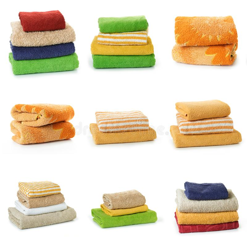 Set of Multicolored towels on a white background. Multicolored towels on a white background royalty free stock image
