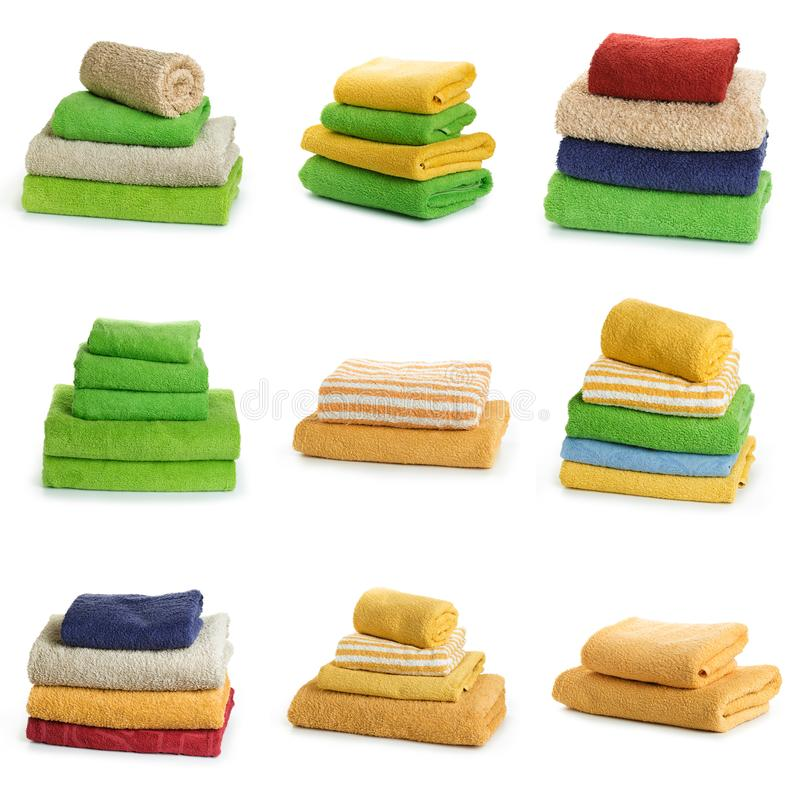 Set of Multicolored towels on a white background. Multicolored towels on a white background royalty free stock photo