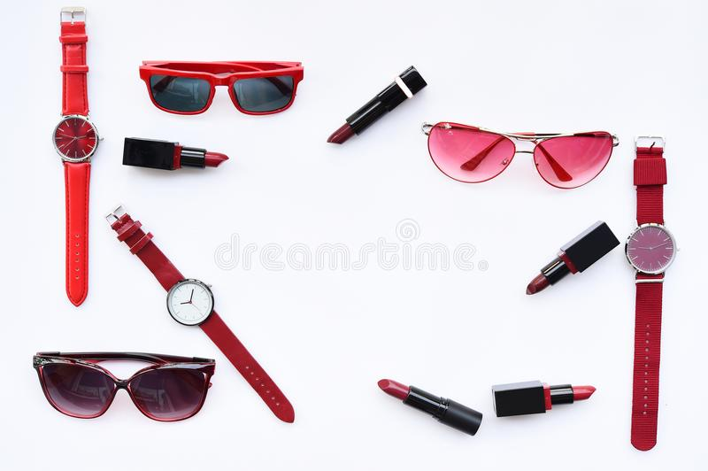 Set of multicolored wristwatches with fashionable sunglasses stock photos