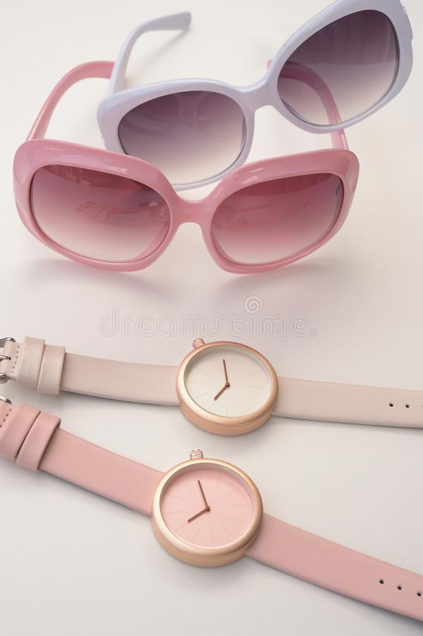 Set of multicolored wristwatches with fashionable sunglasses stock images