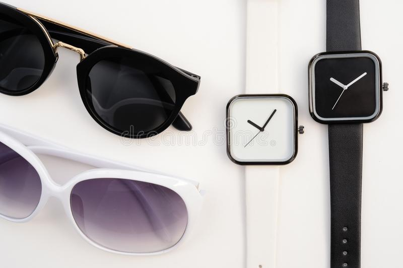 Set of multicolored wristwatches with fashionable sunglasses royalty free stock photo
