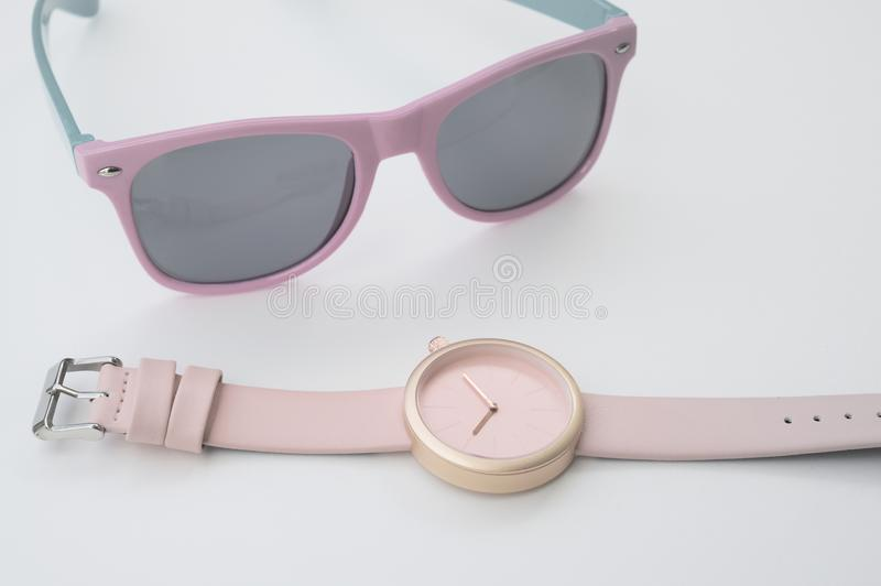 Set of multicolored wristwatches with fashionable sunglasses royalty free stock photos