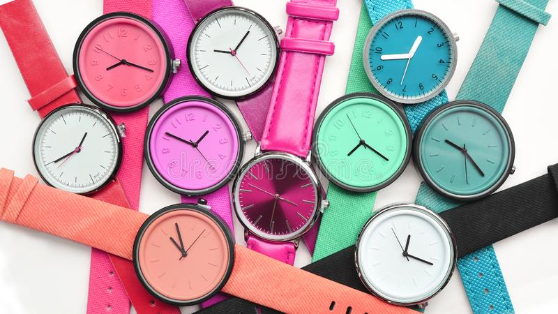 Set of multicolored wristwatches stock photo