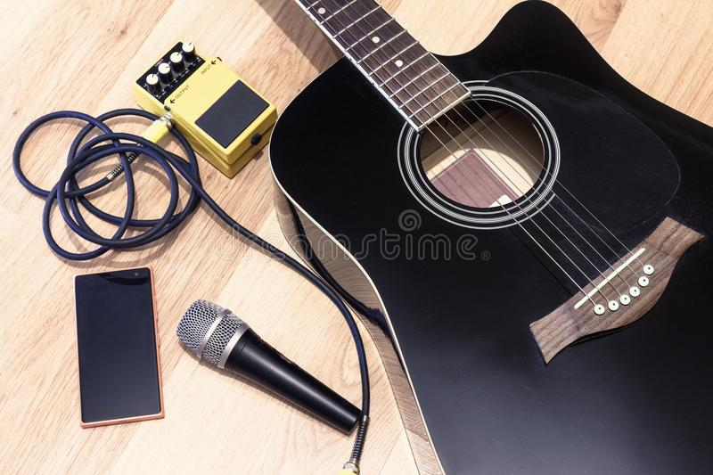 Set of music objects with black accoustic guitar, microphone, mobile music. Set of music objects with black acoustic guitar, ground, package, readiness stock photos