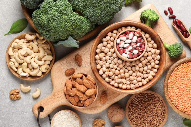 Set of natural food high in protein on grey background. Top view royalty free stock image