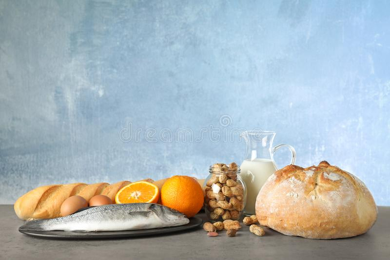 Set of natural products on table against light blue background. Food allergy. Set of natural products on table against light blue background, space for text royalty free stock photos