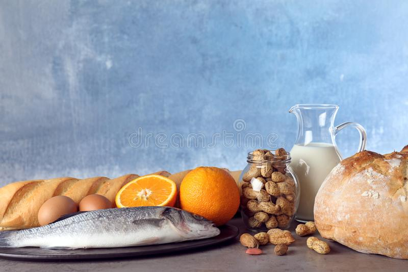 Set of natural products on table against light blue background. Food allergy. Set of natural products on table against light blue background, space for text royalty free stock photography