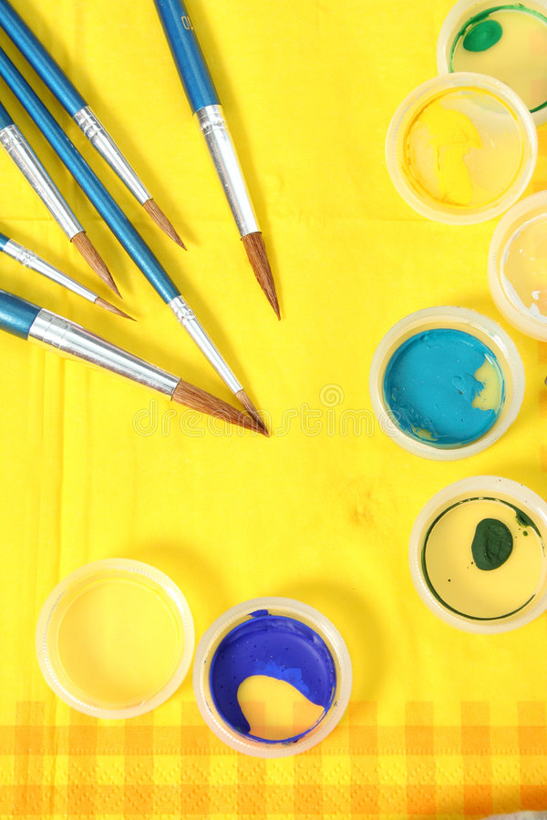 Set of new brushes on a yellow napkin royalty free stock photo