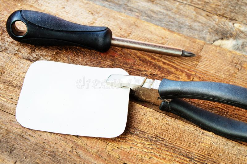 Set of new building tools on old dark wooden background, space for text. Instrument screwdriver pliers hammer wrench jamming used key equipment design vintage stock photos