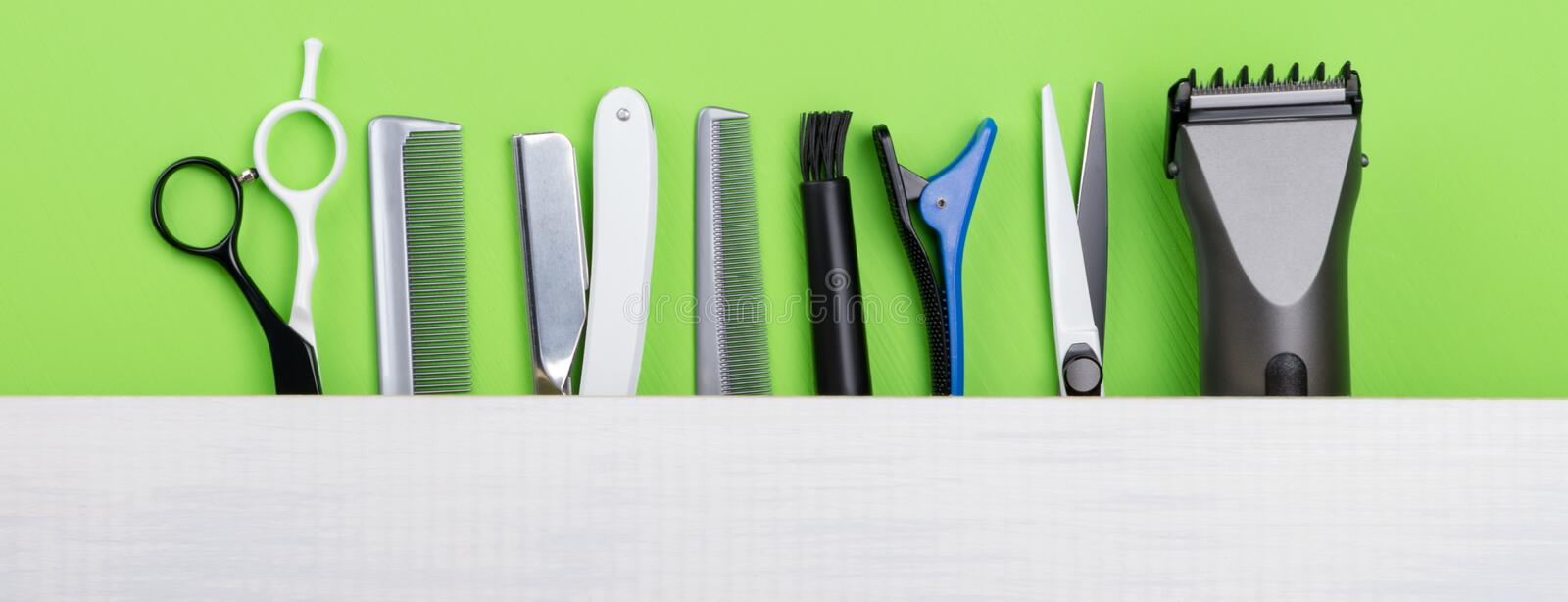 set of objects for creating a hairstyle, on a green background stock photo