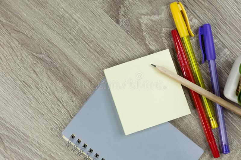 Set of office supplies for work with wood texture background stock photography