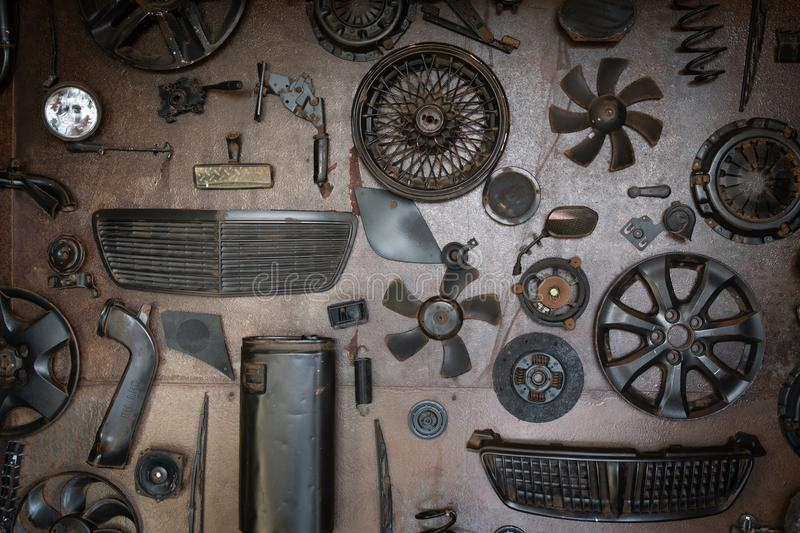 Old car parts on the wall. Set of old car parts on the wall in workshop stock images