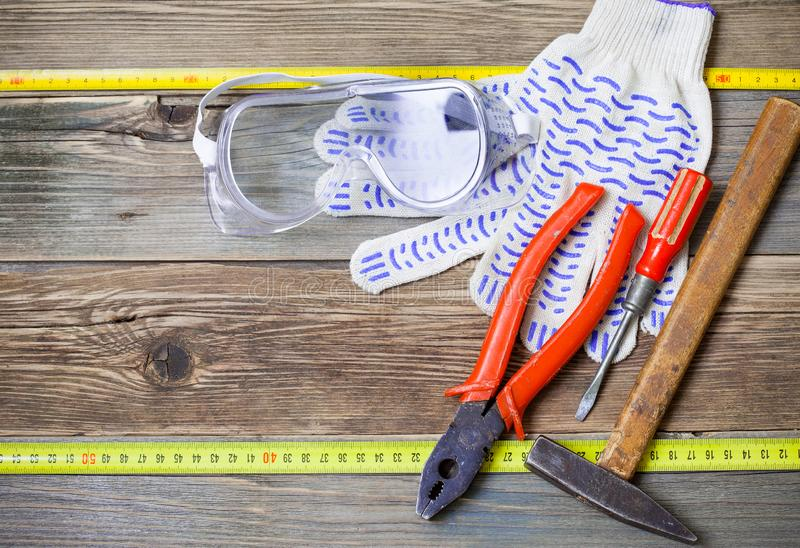 Set of the old locksmith tools, safety glasses and work gloves royalty free stock photo