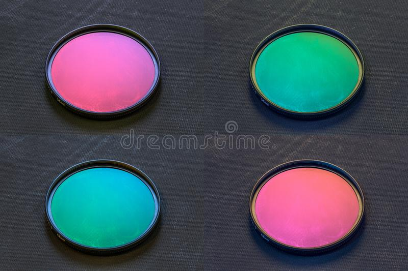 Set of old rotary polarizing filter with stains on dark background. Set of old rotary arizing filter with stains on dark background with different colors stock images