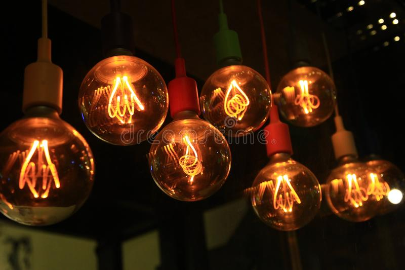 A set of old-style incandescent bulbs hanging on the ceiling. The photo was taken in the cafe `Dead Rabbit`, Nikolaev royalty free stock photos