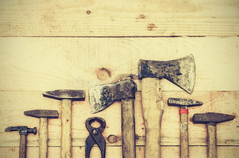 Set of old vintage hand construction tools on a wooden background, well used retro concept.  stock photo