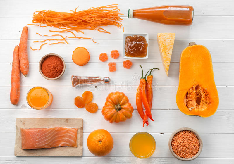 Set of orange objects, pumpkin and carrots, topview stock photography