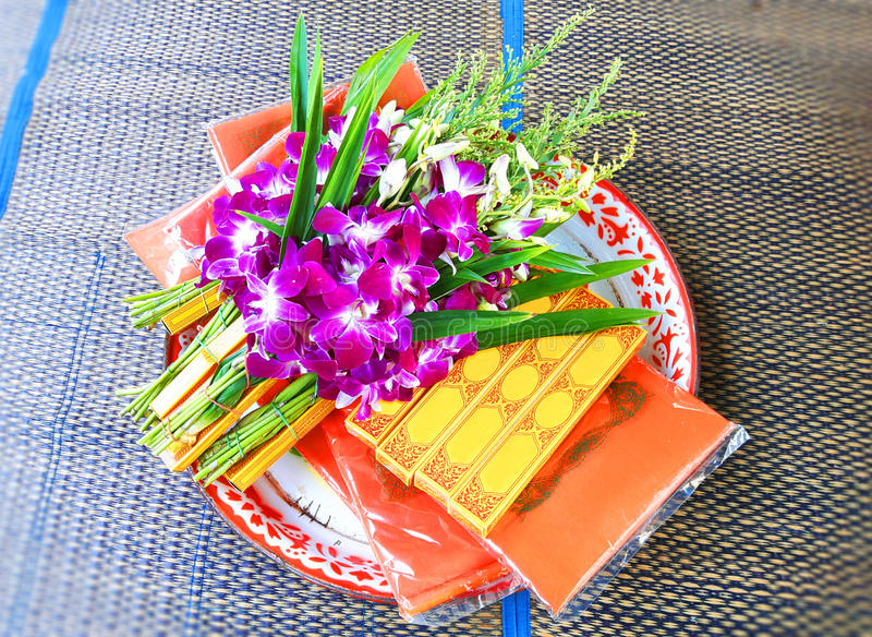 Set of orchid flowers, candles, and incense for holy spirits stock images