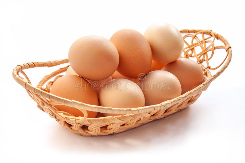 Set of organic eggs. Organic eggs in the basket on the white background royalty free stock photography