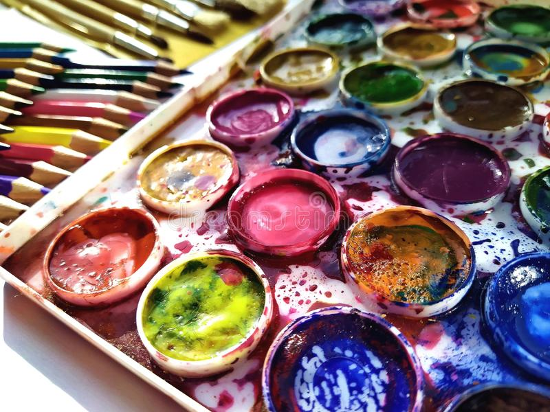 Set of paints. bright colours . splattered with paints. royalty free stock image