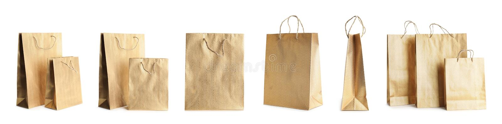 Set of paper shopping bags on background. Banner design. Set of paper shopping bags on white background. Banner design stock photos