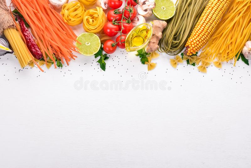 Set of pasta, noodles, spaghetti. Italian cooking, fresh vegetables and spices. On a white background. Top view. Copy space royalty free stock photos