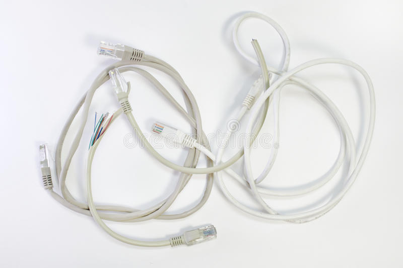 set of patch cords with different color top wire insulation, wound into a ring and the trimmed ends of the wires stock photography