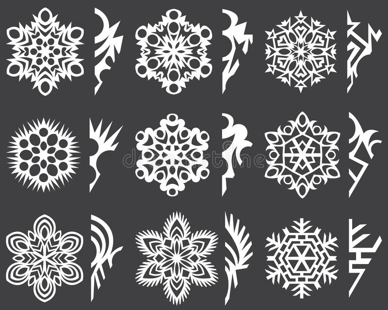 Set of patterns for cutting christmas snowflakes . royalty free stock images