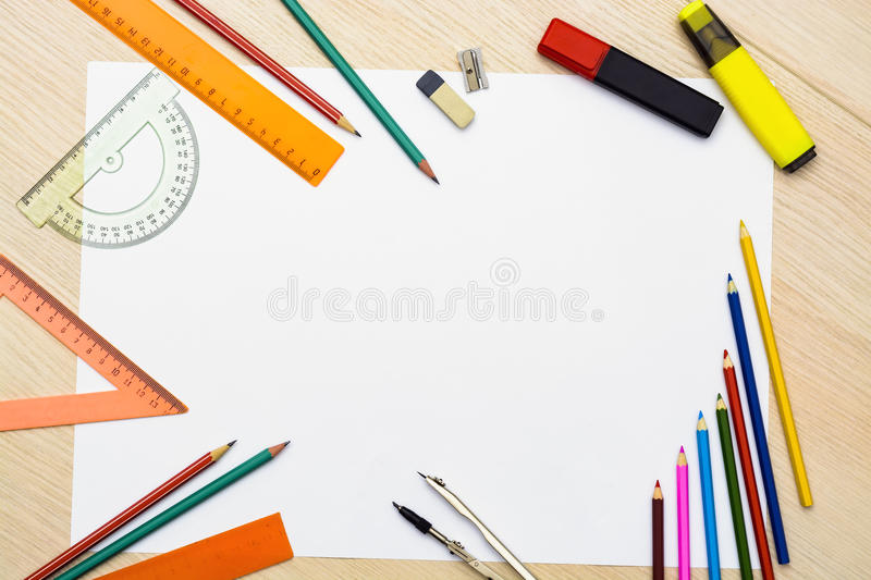Set of pencils, erasers, post-its and other useful supplies for the school. There is a centered blank sheet for text writing royalty free stock photos