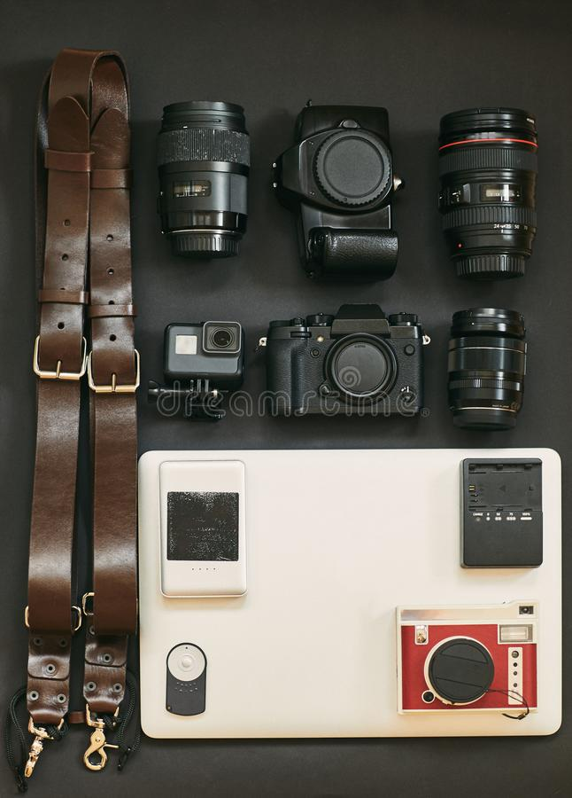 Set of photographer for travel. The layout of the cameras. My set of photo equipment. royalty free stock photography