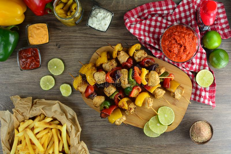 Grilled Chicken Skewers with Vegetables, French Fries and Various Dips - a set of photos showing an entire recipe preparation stock images