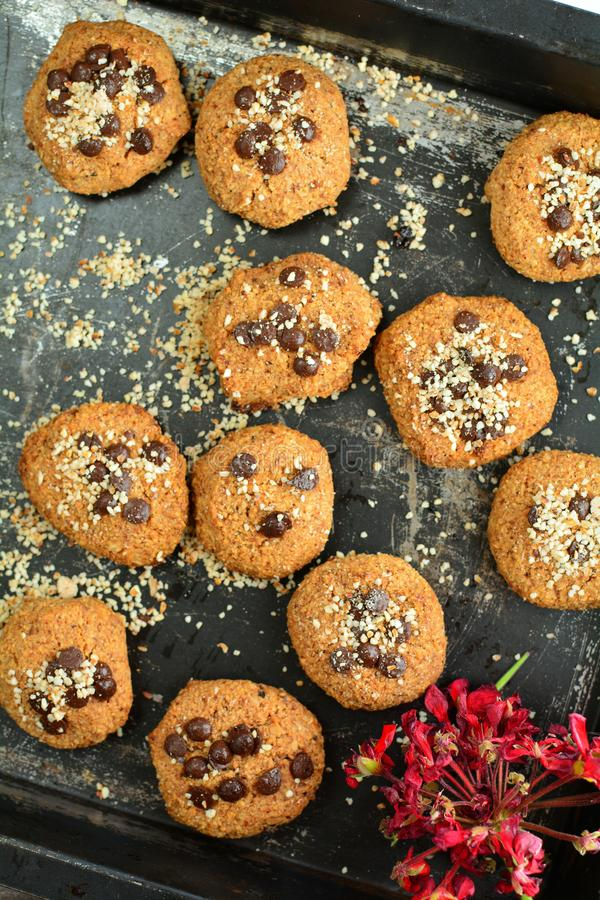 Keto Peanut Butter Cookies with Almond Flour and Sugar-Free Chocolate Chips. A set of photos showing a delicious sugar-free cookies with almond flour and peanut royalty free stock image